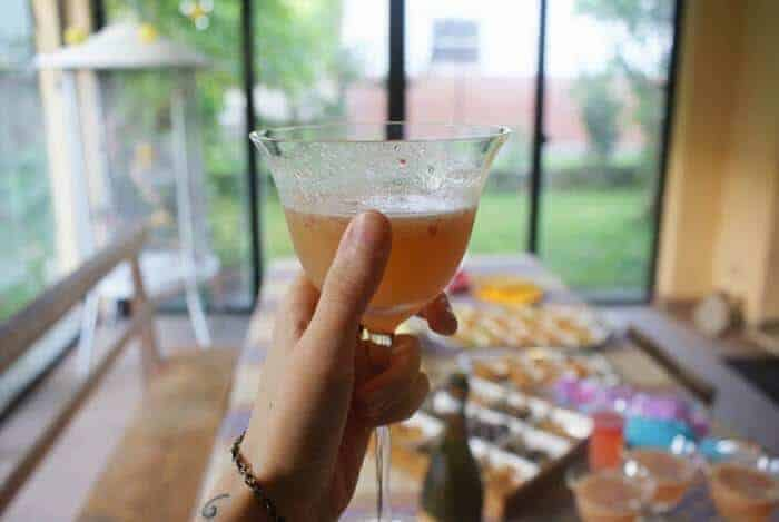 champagne cocktail being held by hand