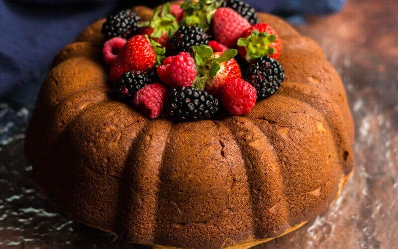 cream cheese pound cake with raspberries and blackberries on top
