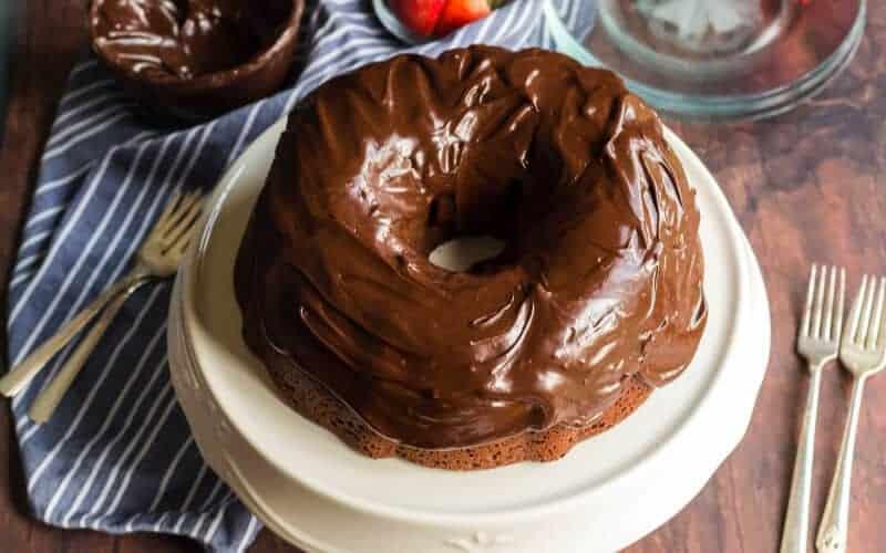 chocolate sour cream pound cake, wood, blue and white striped napkin