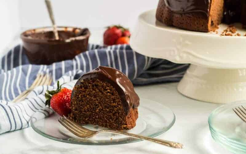 piece of chocolate sour cream pound cake with strawberry white cake plate