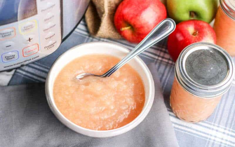 instant pot applesauce on table with instant pot