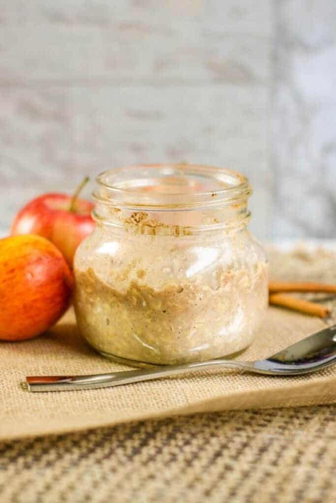 this apple pie overnight oats in a mason jar by an apple