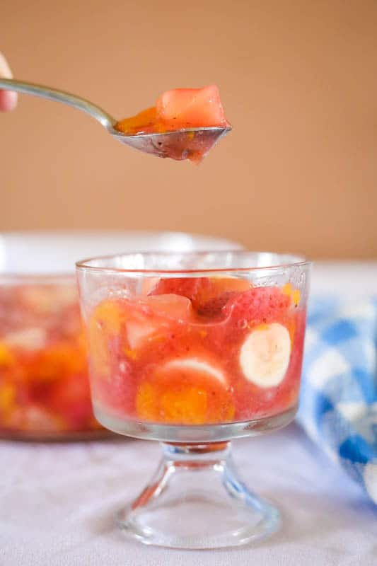 spoon eating fruit salad with peach pie filling
