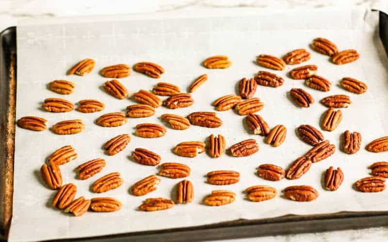 pecans on dish ready to roast and use in pecan pralines