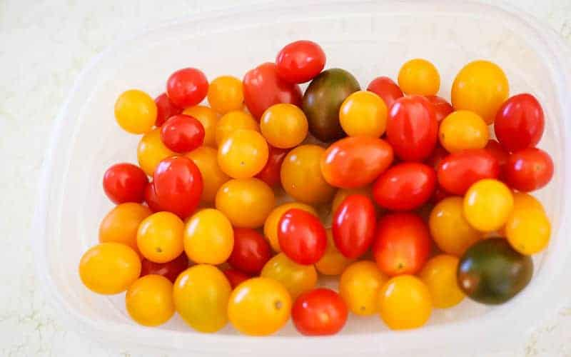 cherry tomatoes in container ready to be pickled