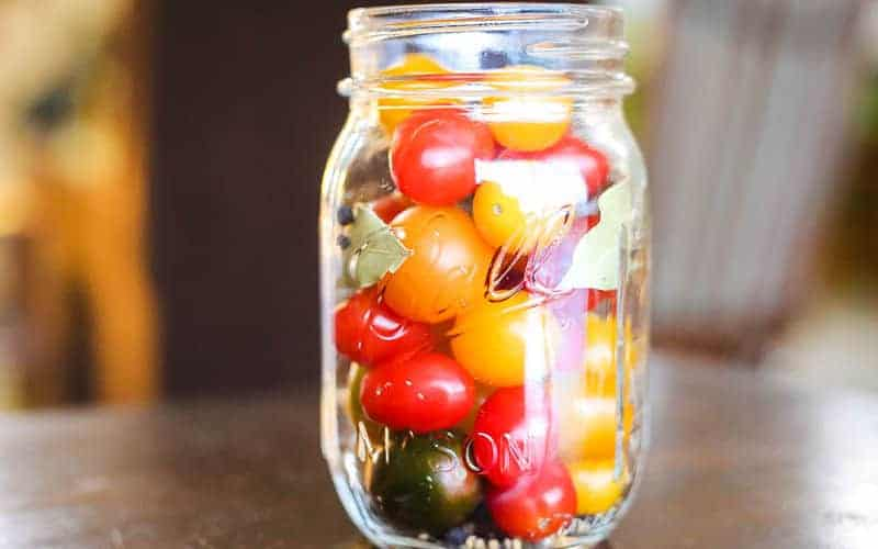 pickled cherry tomatoes in a ball mason jar