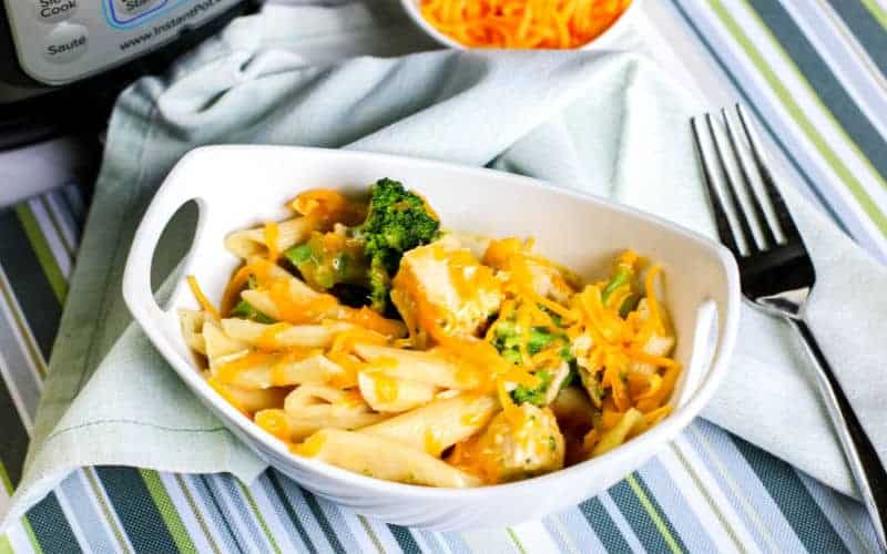 penne pasta with chicken and broccoli in a white bowl