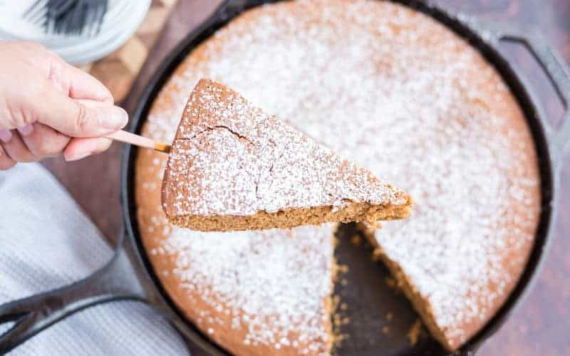 piece of syrup cake with confectioners sugar on top