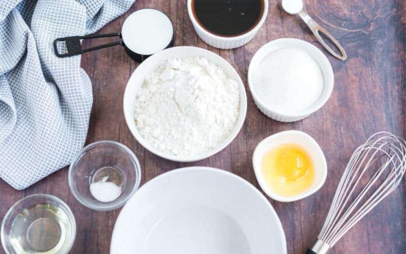 ingredients for the syrup cake on a wooden table