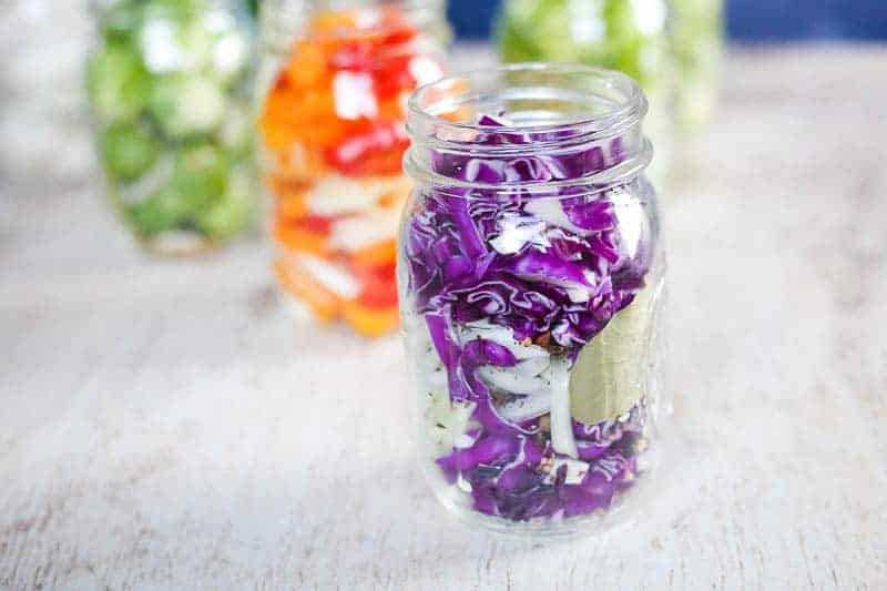 shredded cabbage in a jar with spices ready to quick pickle