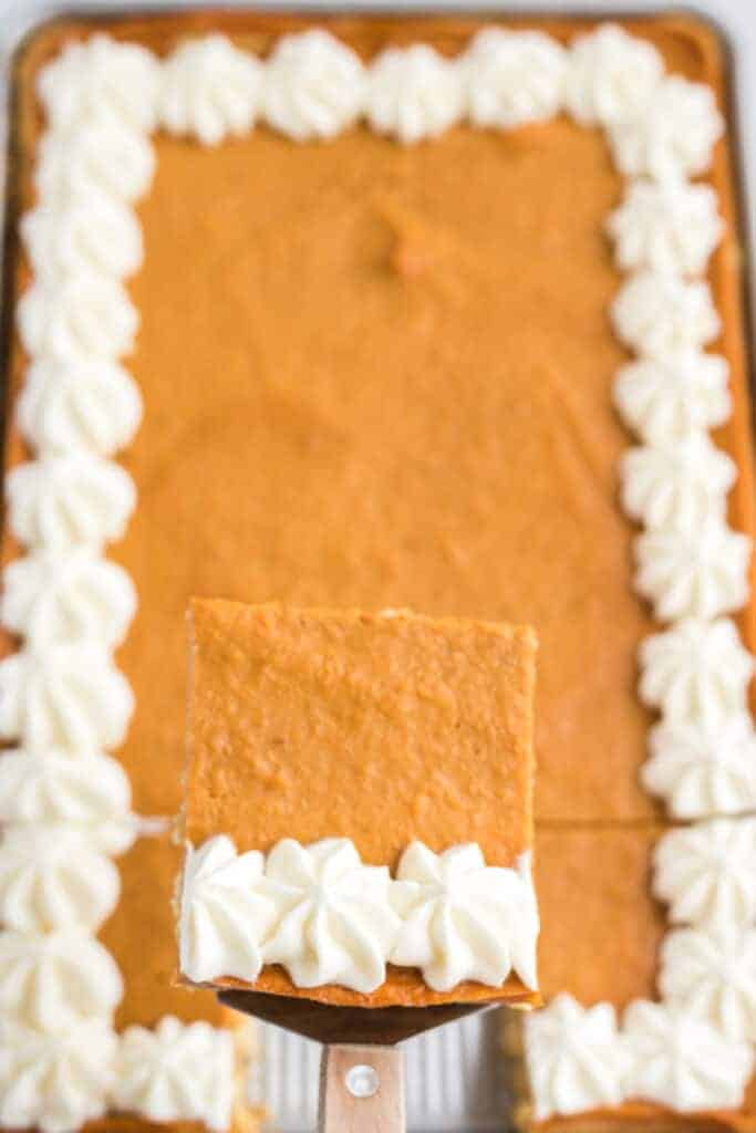 sweet potato slab pie with whipped cream on a fork