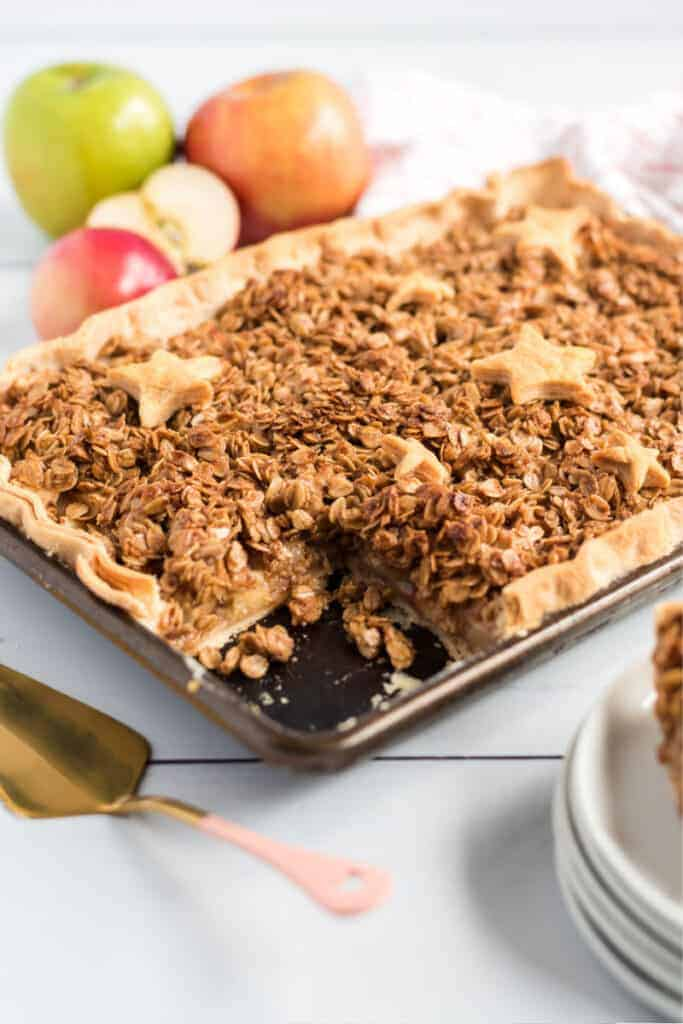 apple slab pie with star crusts and apples on table