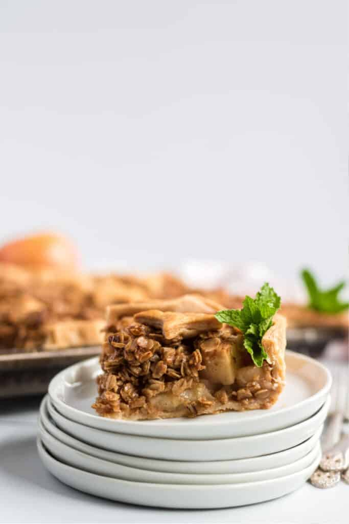 lovely apple slab pie on stacked white plates