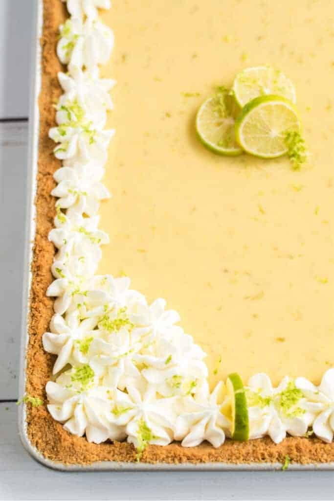 key lime slab pie with key limes and whipped cream