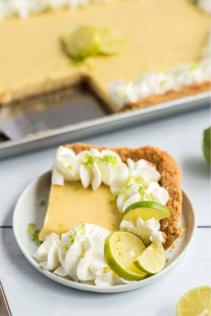 key lime pie on white plate with lime zest shavings