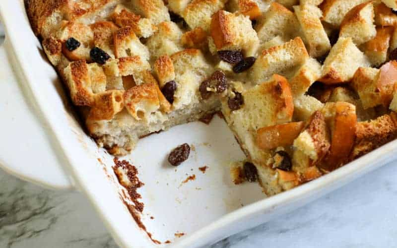 bread pudding in casserole dish on marble table